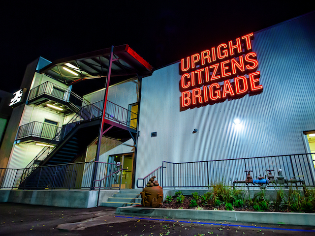 """Upright Citizens Brigade Announces the Grand Opening of UCB Theatre Sunset The Upright Citizens Brigade is opening a brand new theater in Los Angeles. UCB announced today that it'saddeda new venue called UCB Theatre Sunset located at 5419 Sunset Boulevard in LA, which will be home to UCB LA's training center for both improv and sketch writing, an 85-seat theatre, cafe/performance space called Inner Sanctum (featuring """"a highly-trained team of baristas"""" and """"an incredible art and sculpture collection""""), video production offices, and even retail stores on street level. Classes at the new location will start in November, and the theater will celebrate its grand opening on November 1st with a whole day of comedy. Performers slated to show up throughout the day include UCB Four Amy Poehler, Matt Besser, Ian Roberts, and Matt Walsh along with other UCB alums from both LA and New York. The original LA UCB Theatre on Franklin Avenue will continue to put up shows seven nights a week. Read more about the new training center and cafe via UCB's press release below: The highly anticipated new Training Center at UCB Theatre Sunset will house 14 classrooms, with three of those classrooms dedicated to sketch writing. The Training Center will have a full reception area, conference room and administrative offices. In 2013 alone, UCB Theatre Franklin offered 550 courses which they expect to increase significantly with the new Training Center. The new café will offer a second location within UCB Theatre Sunset for performances. The Inner Sanctum has a highly-trained team of baristas who will be serving everything from fresh brewed coffee and espresso from Stumptown Coffee Roasters to hand-made sandwiches and snacks. The Inner Sanctum's work-space and gallery provides separation from the counter service environment, where diners, students, and performers can relax and hang out on the ample couches, lounge chairs, and tables. An incredible art and sculpture collection compliment the loun"""