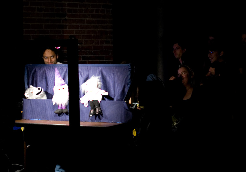 UCB-LA | Seth & Ed's Puppet Show | 04.19.08 Back in the day, Seth Morris and Ed Helms did a monthly talk show in which they would interview guests as themselves, but in puppet form. That night, Jason Mantzoukas was interviewed, and took the form of that wolf puppet on the left. When the interview turned to dating, Manzoukas asked the ladies in the audience about having sex on the first date. As the audience clapped, he slooooowly creeped out behind the puppet stage to see who was clapping in response to his question. I didn't know who he was at the time, but this was the definitive moment I became a fan of him.