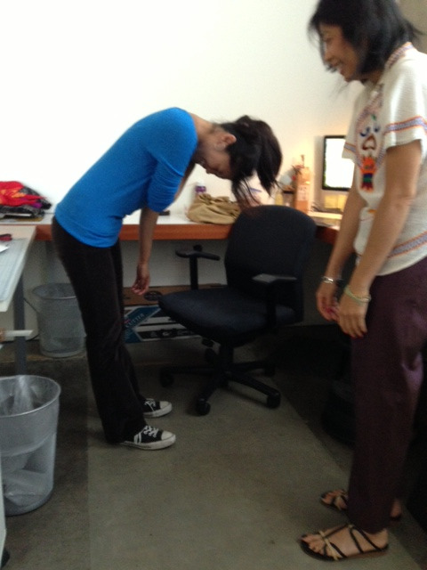 idigress: Uyen helping Liezl stretch her neck. Liezl trying to scowl I hurt my neck and shoulder this morning, causing me to walk around like a robot. It angers me that I couldn't turn my head to scowl at my boss for taking this picture.