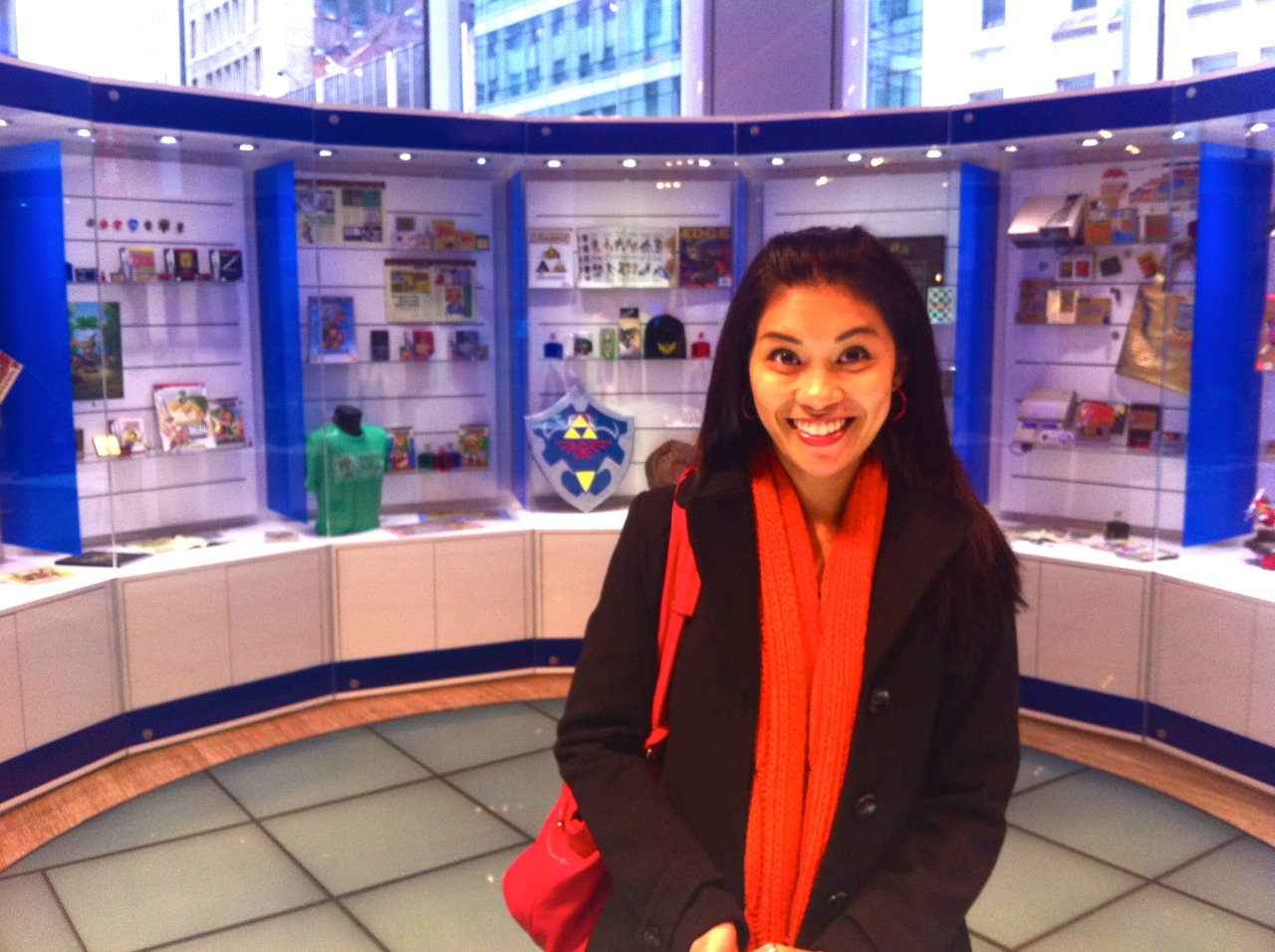 Aside from my quest for donuts, this is the only other thing I requested we visit.    joggingmymemory :     Liezl in front of the Zelda display at the Nintendo World store in NYC.