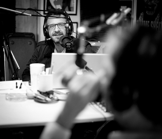 WTF with Marc Maron | 10.05.11 I was fortunate and super honored to listen in for a bit on a taping today. Some notes. The garage is really just that, a tiny one car garage detached from his house. For those who have ever wanted to sit in on a taping, it's strange. The space is so small it doesn't lend itself to an audience of any kind. I basically wanted to get my shots and get the fuck out because I felt like I was eavesdropping. So if you ever want to go to a taping, stick to the live ones at The Steve Allen Theatre. Maron doesn't waste any time. Once the guest gets there, it's a minute or two of talking before they head to the garage. He starts recording and gets to know the guest right there on tape for us to hear. He keeps everything fans give him. The garage is full of fan artwork and gifts… it's pretty damn amazing how fans are using their talents to create artwork. I think I saw a 2.5'x3' portrait of Maron made out of beads. He has an amazing set of guests lined up for next week… while I'd love to sit in on that, my overwhelming sense of claustrophobia in the garage tells me I'm happy enough with the shots I got today. No, I can't tell you who today's the guest was because Maron hasn't tweeted it yet… but it was very cool to be in the same room with him.