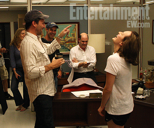 … hey, there's my roommate Marcy on set doing important things like holding a radio.    popculturebrain :     First Look:  Mad Men  season 5 on set photo: Jon Hamm directs Elisabeth Moss | EW.com    Something tells me they're not in costume yet.
