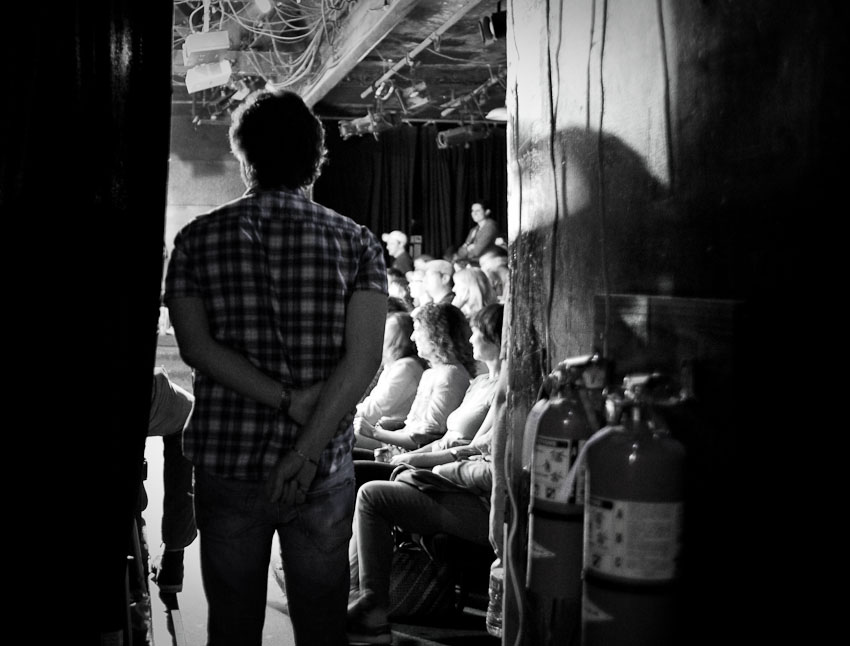 UCB-LA | Comedy Bang Bang | 06.21.11 Marc Maron watches Louis CK from behind the curtain. Since the show is an unannounced mixed bag of comedians, it was fun watching the audience's reaction as they came out on stage, knowing that most of them are probably waiting for a Galifianakis to drop in…. still, a Louis CK and Marc Maron aren't bad at all.