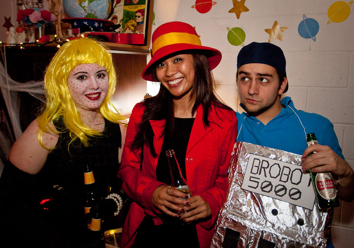 Halloween at Kibblesmith's | 10.30.10    Lynnea as a living breathing Lichtenstein, Carmen Sandiego and Joe as Brobot, whose rape levels were fortunately low at this point of the night.