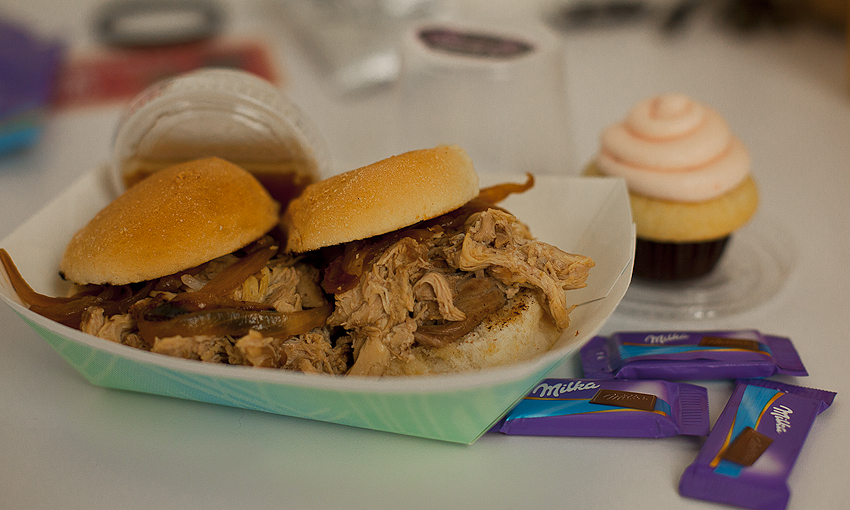 Hunting the Food Trucks….   Manila Dip  - Shredded chicken adobo Sliders with caramelized onions from  The Manila Machine  and some random cupcake from  Sweet E's Mini Bake Shop.