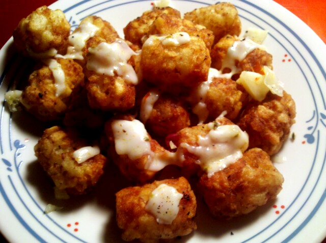 Trader Joe's Tater Tots topped with monterey jalapeno cheese.