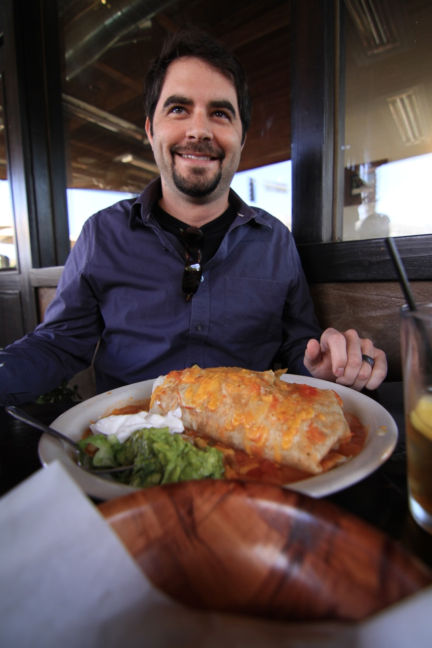 busyatwork :     Lunch for two?     This is my boss, and here is the disgustingly large burrito he had for lunch yesterday.