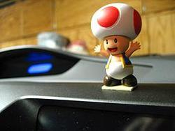 To top off the long and already horrible night, I just realized the Valet service not only took my ipod, but my this little guy. I got him a couple years ago at the Nintendo World Store in NYC to commemorate my new car. He fell off my dashboard recently so he had been sitting in my cup holder.    You're a real piece of garbage .  Fuck you valet service on Horn & W. Sunset.