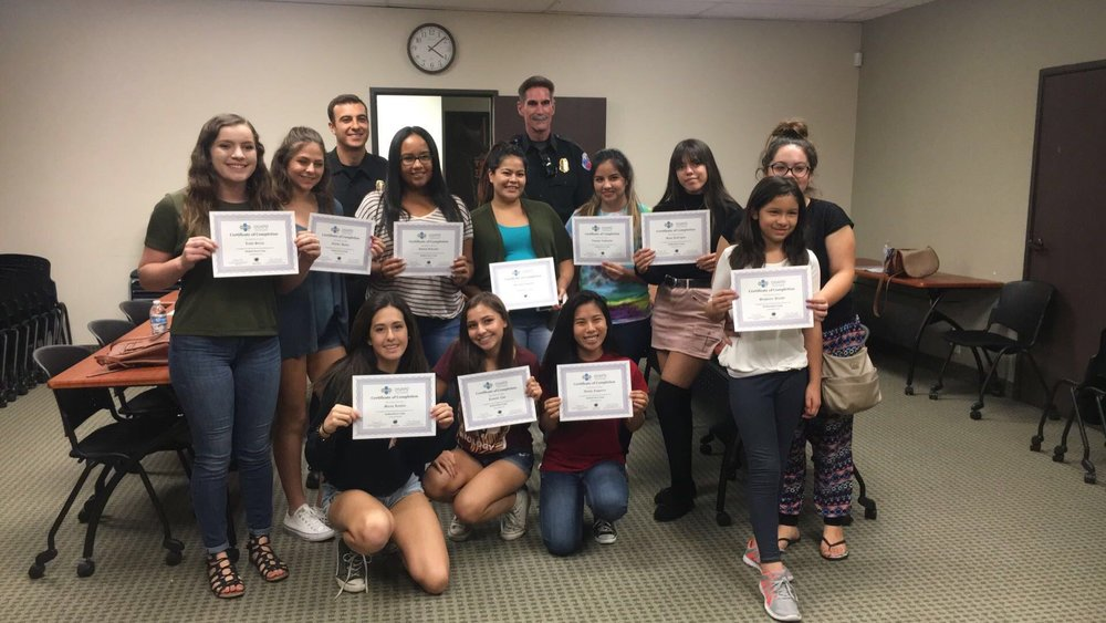 Some students show off their CPR certification.