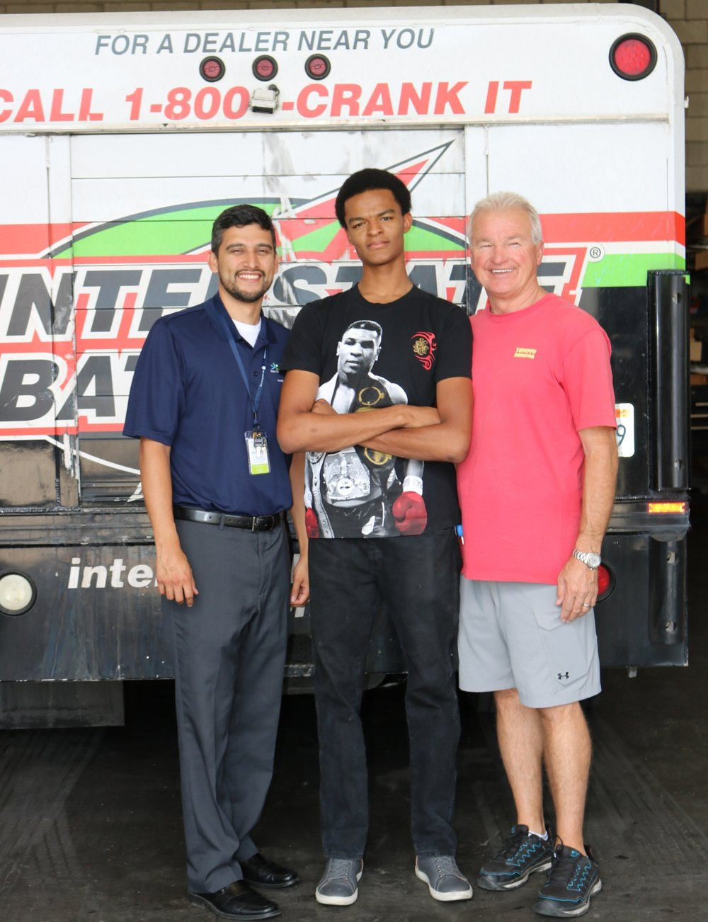 Looking determined, Israel Clayton [center] poses with Jorge De Leon [left] and Rick McCray [right].