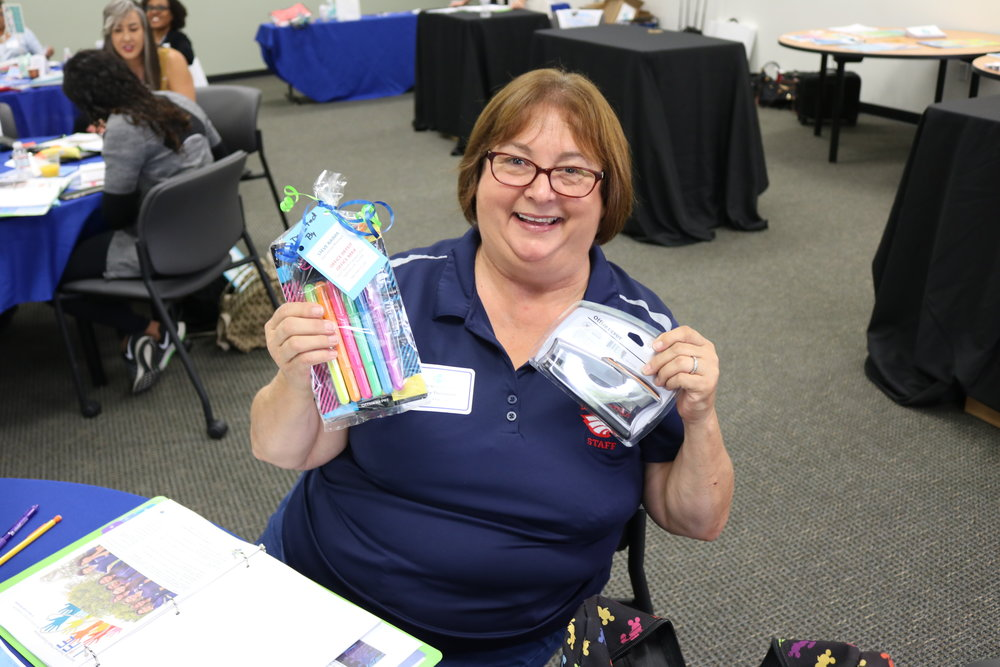 Kathy Thompson from La Sierra High School shows off the new school supplies she won.