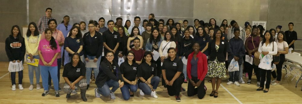 Student attendees and their parents pose for a group shot at PHS gym.