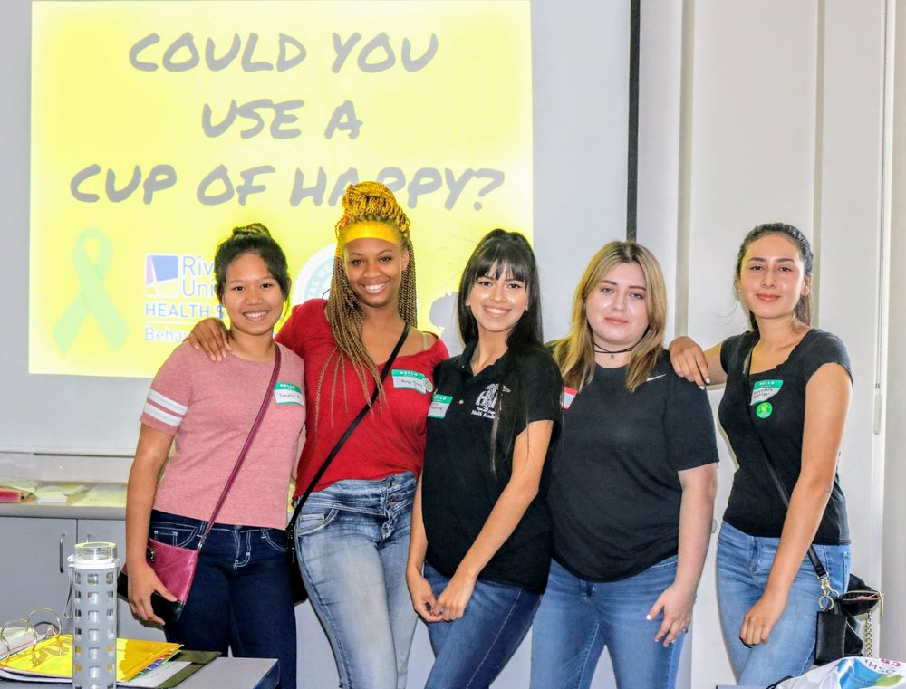 All Smiles! Encompassing Mental Health students from CNUSD embrace Cup of Happy!