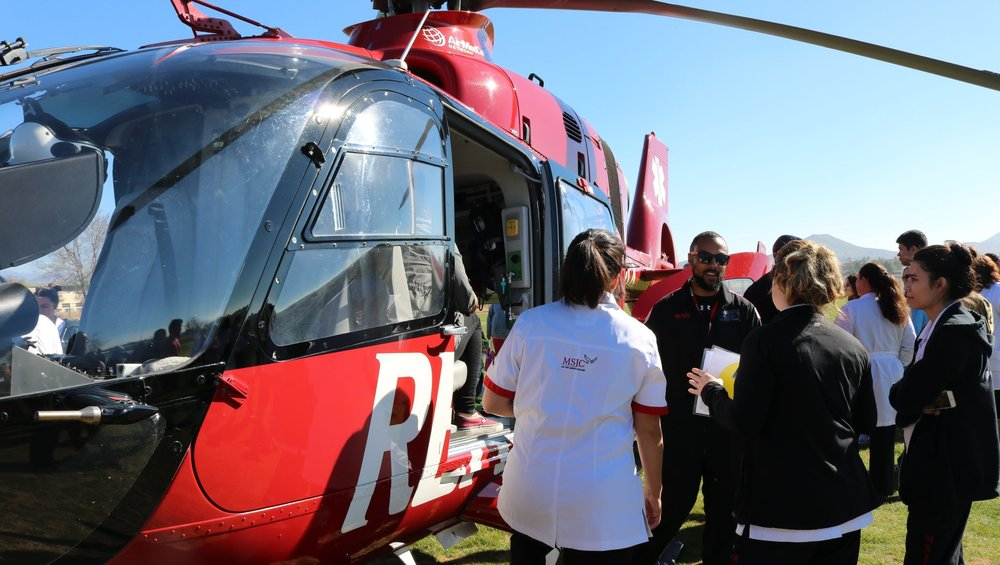 Students talk to one of Reach's air medics during a brief tour of the helicopter.