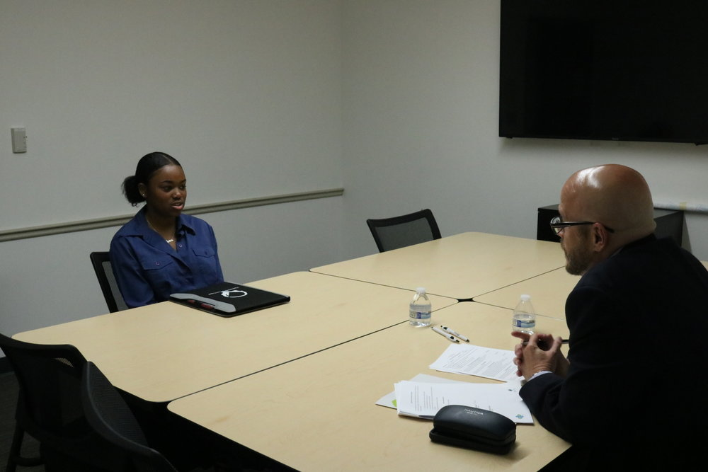 "WUHS faculty conduct ""mock"" job interviews with #ABC students."
