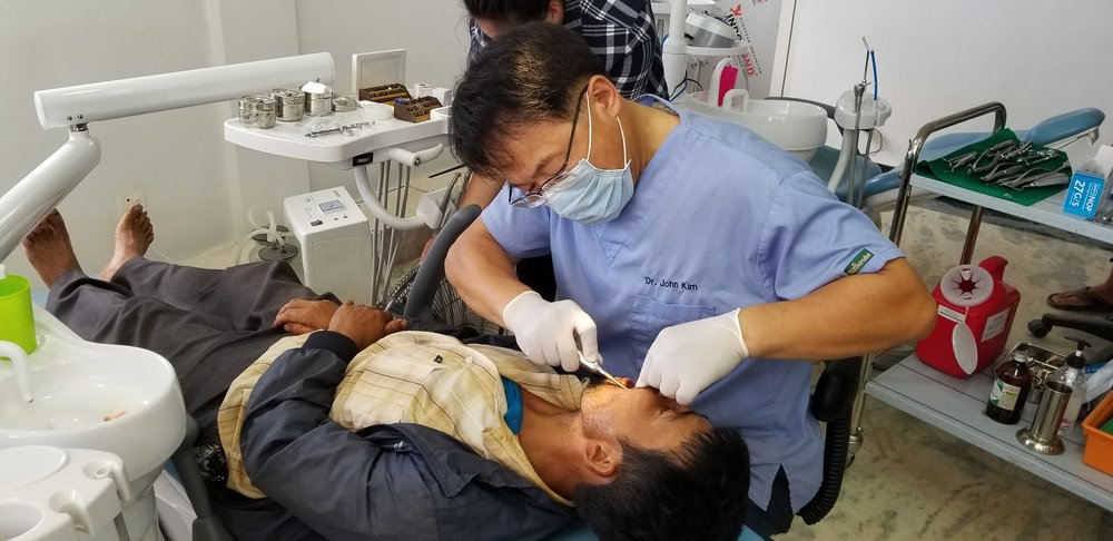 Ted assisted dentist in a Nepalese village as part of a mission trip.