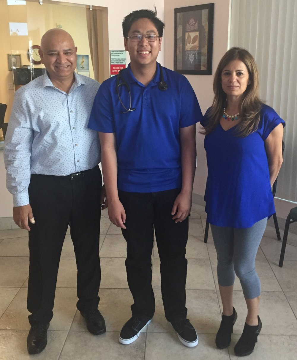 Mark is all smiles with Dr. Abid Hameed Khan and office manager Joanna Ryckman.