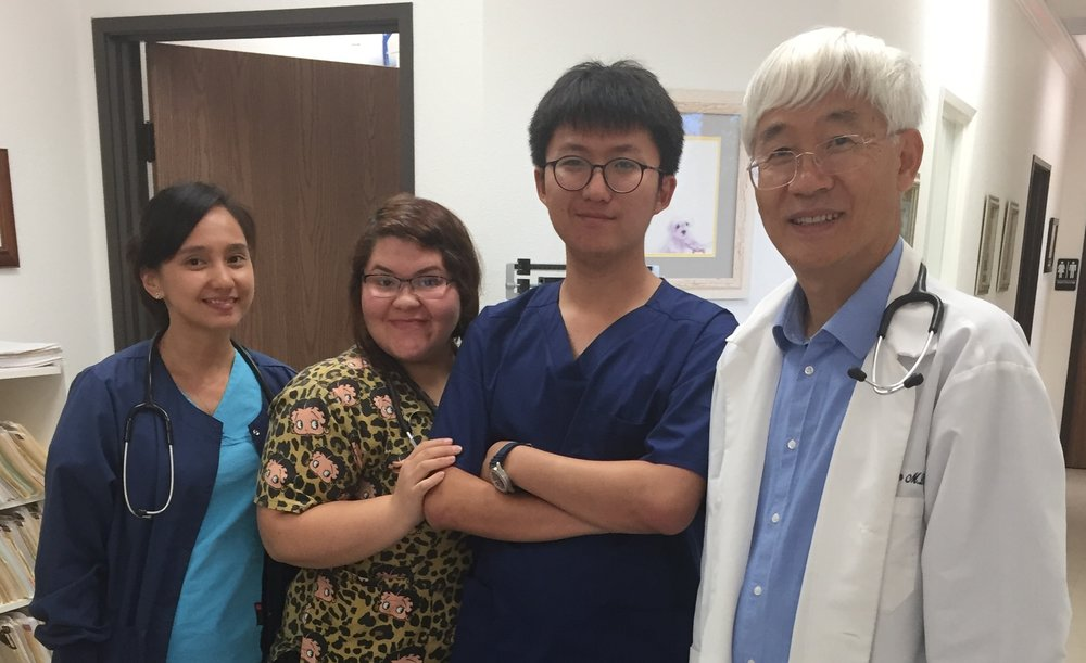 Ted poses in Dr. Kim and his staff during his LIFE experience.