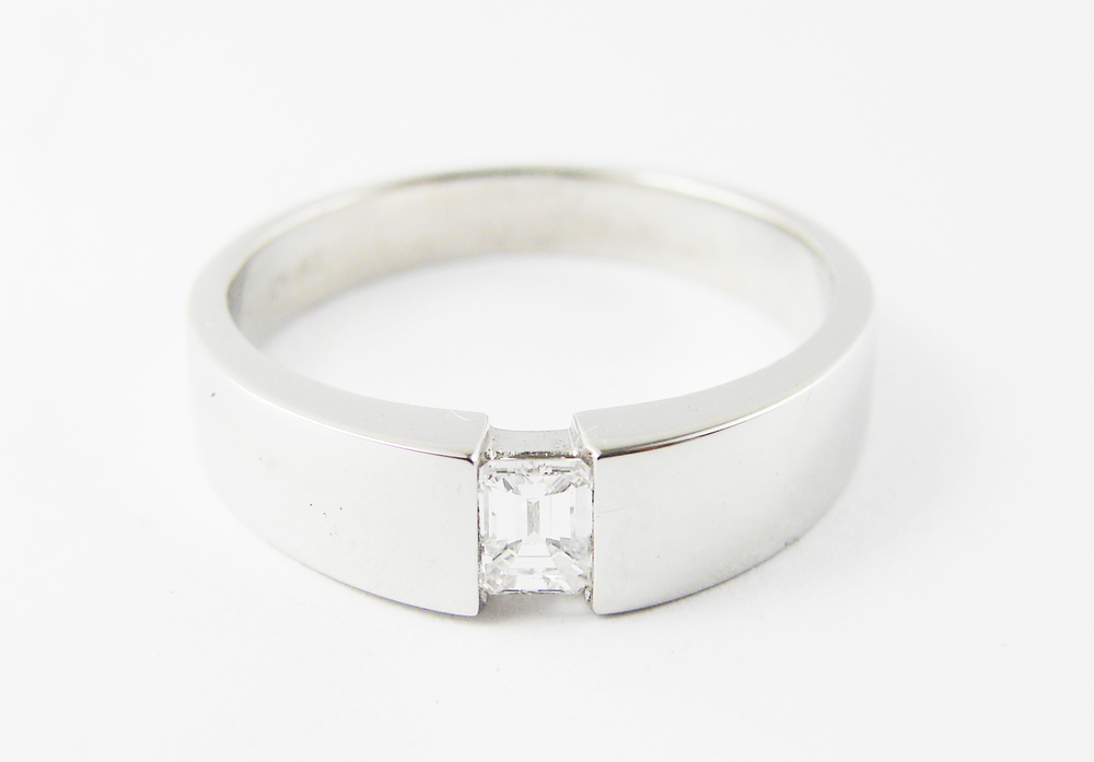 18kt white gold, 0.50ct emerald cut diamond, unique and modern low profile setting.  Starting at 2200 for this stone size and quality  Can be customizable with any stone, size, metal etc.