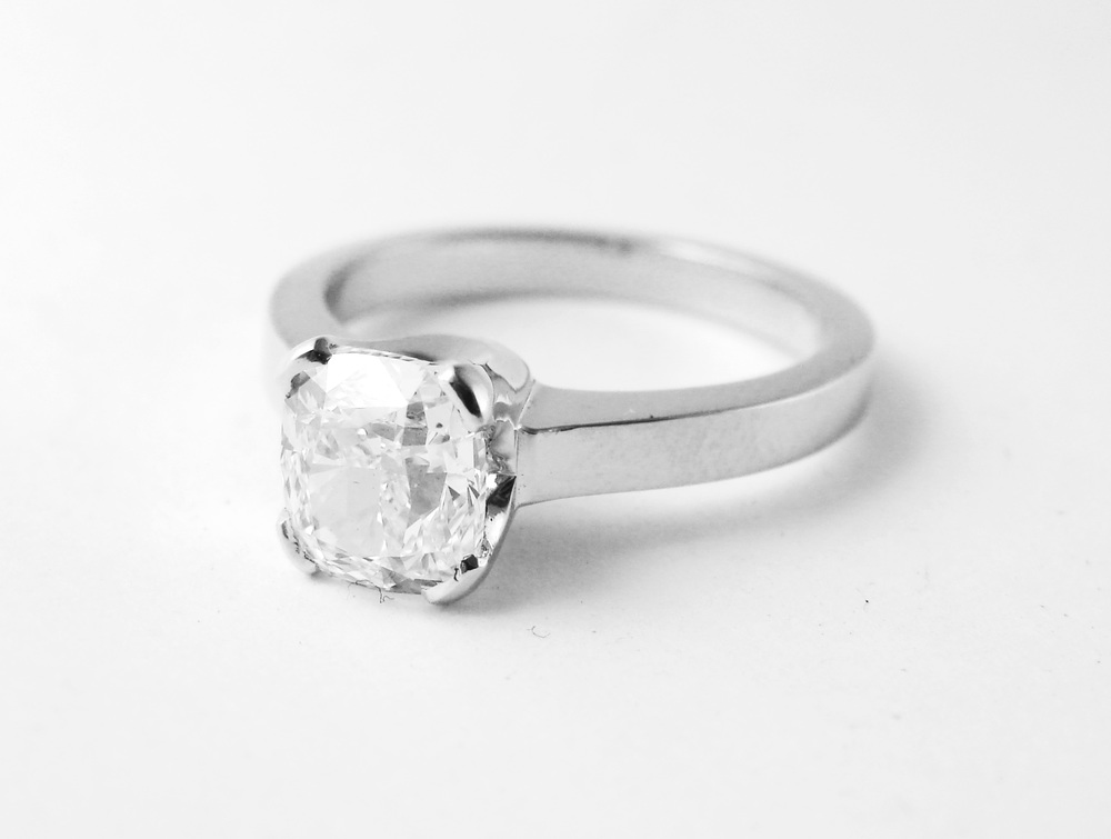 1.35ct square radiant cut diamond, set in a simple and elegant platinum setting.  Starting at $10,000 for this stone size and quality  Can be customizable with any stone, size, metal etc.