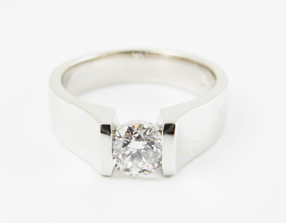 0.55ct round brilliant cut diamond tension set in a heavy platinum setting.  Starting at $6000 for this stone size and VVS-2 clarity F colour  Can be customizable with any stone, size, metal etc.
