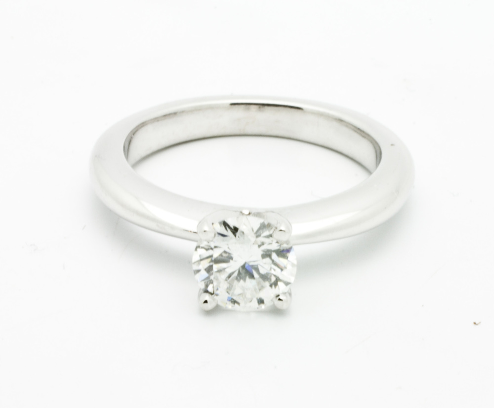 0.42ct round brilliant cut diamond center stone,14kt white gold, traditional 4 claw solitaire ring.  Starting at $2000 for this stone size and SI-1 clarity F colour  Can be customizable with any stone, size, metal etc.
