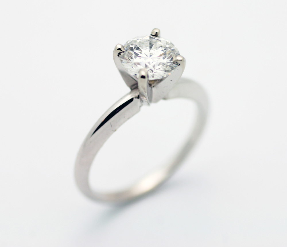 1.15ct round brilliant cut diamond center stone, classic 4 claw rounded shank, 14kt white gold solitaire ring.  Starting at $5100 for this stone size aSI-2 clarity I colour  Can be customizable with any stone, size, metal etc.