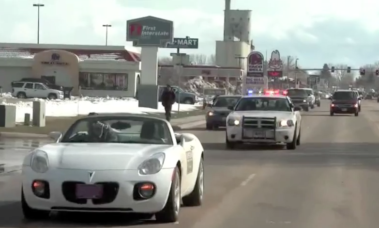 John driving blind with a police escort - 2009