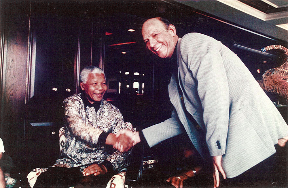Neil with Nelson Mandela.