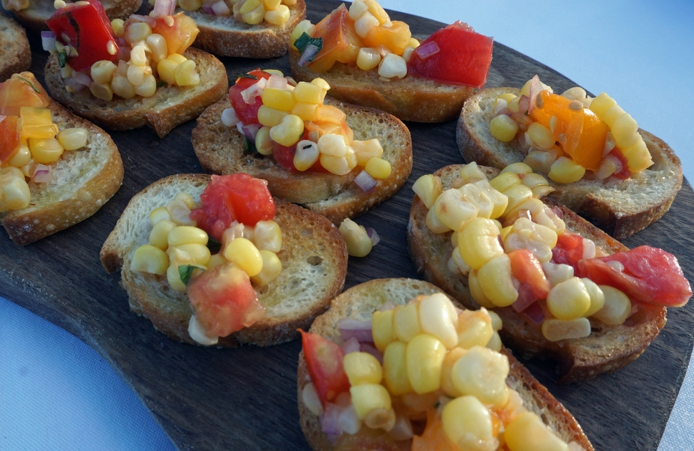 Tomato and Corn Bruschetta. Could eat a thousand of these.