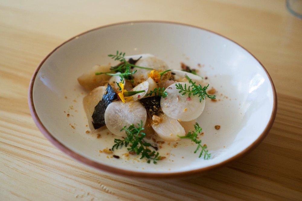 Roasted and marinated turnips, preserved cherry blossom and almond.  Photo by Alycia Chrosniak