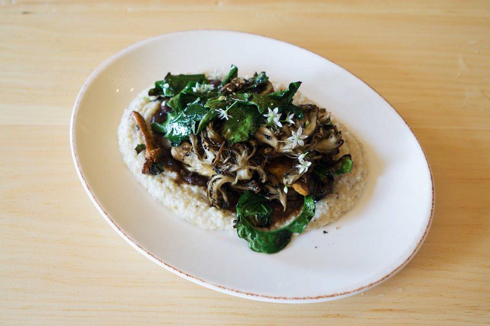Wood-roasted mushrooms, charred spigarello, soft polenta, yellow-eye bean and rosemary gravy.  Photo by Alycia Chrosniak