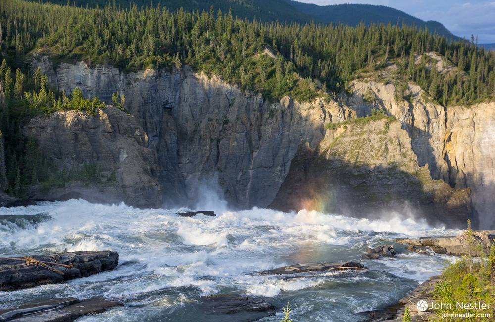 Sunlight playing off the spray of Virginia Falls on the Nahanni River.