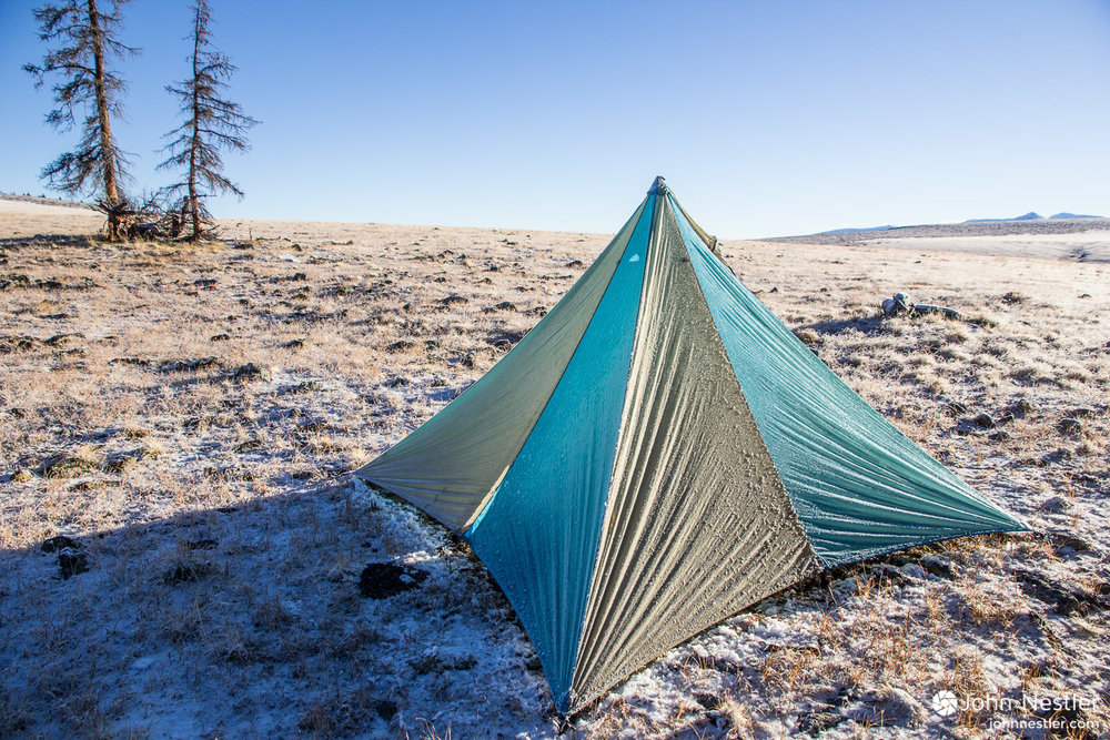 Waking up to a clear, freezing morning as hail from the night before still clings to the tent. A couple hours of sun melted the tent as well as my clothes, making the rest of the day much more comfortable. Shot in the Jarosa Mesa area in Segment 22.