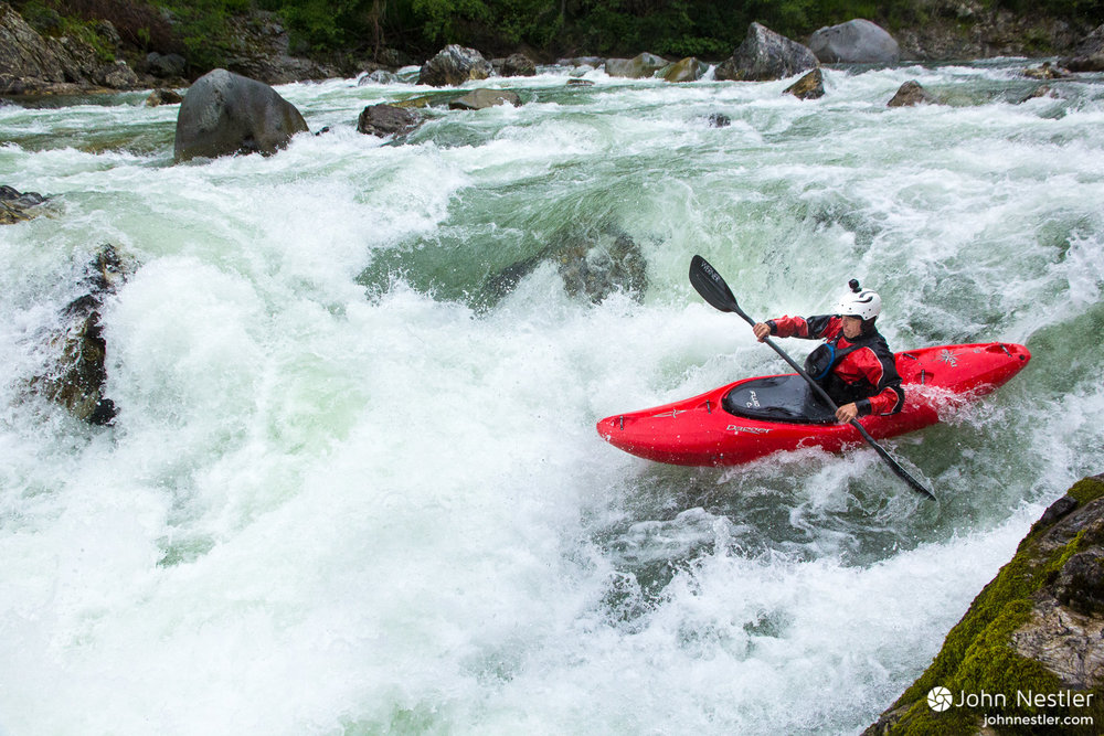 Jordan charging into the entrance of Cascade rapid. The water level allowed for a variety of line options.