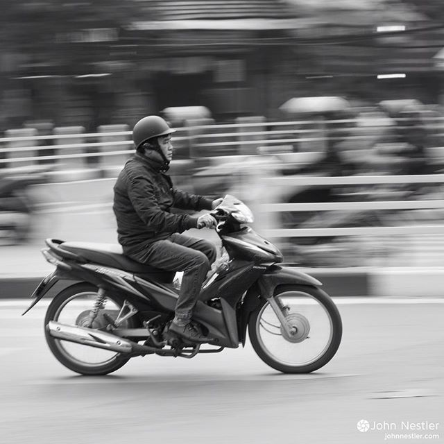 Vietnam is a country of roughly 90 million, yet there are over 37 million registered motorbikes. Cars are both cost-prohibitive for the majority of the country as well as cumbersome on the streets. The constant barrage of motorbikes keeps you on your toes, and held my attention during the first few days in Hanoi. Shot in 2015.  #vietnam #hanoi #motorbike #scooter #moped #urban #street #travelphotographyasia