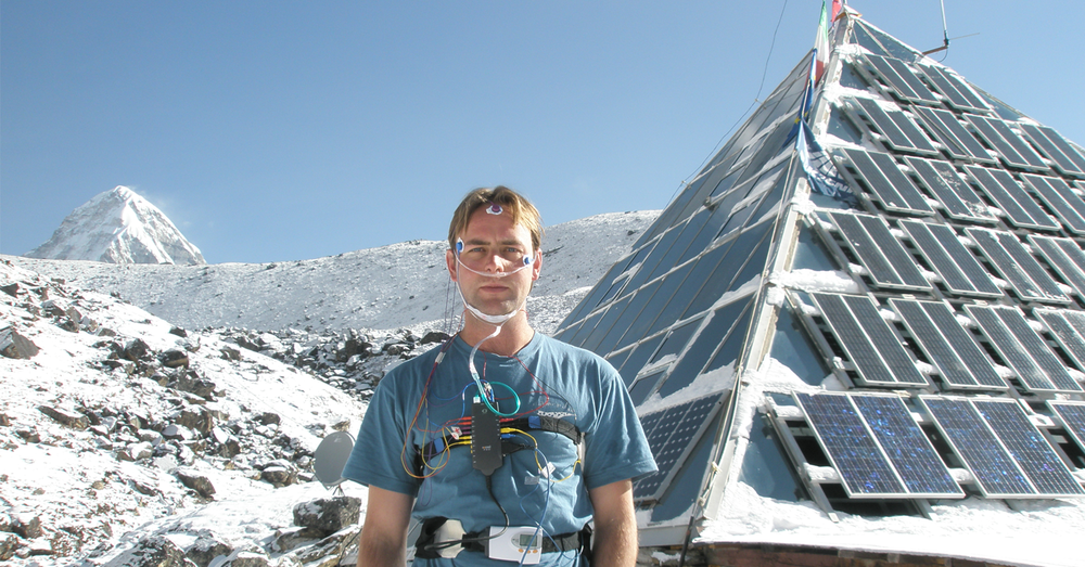 Andrew outside The Pyramid, a high altitude research laboratory located near Mt Everest in Nepal, wired up with electrodes after an overnight sleep study. Summit of Pumori visible in background.