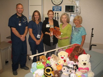 Cox Medical Center Branson Emergency Room staff Tim Costello, from left, Kristen Cardwell and Trauma Coordinator Angelina Hein accept a donation of stuffed animals from JATC members Treasurer Rita Parsons and Secretary Kathleen Brown.