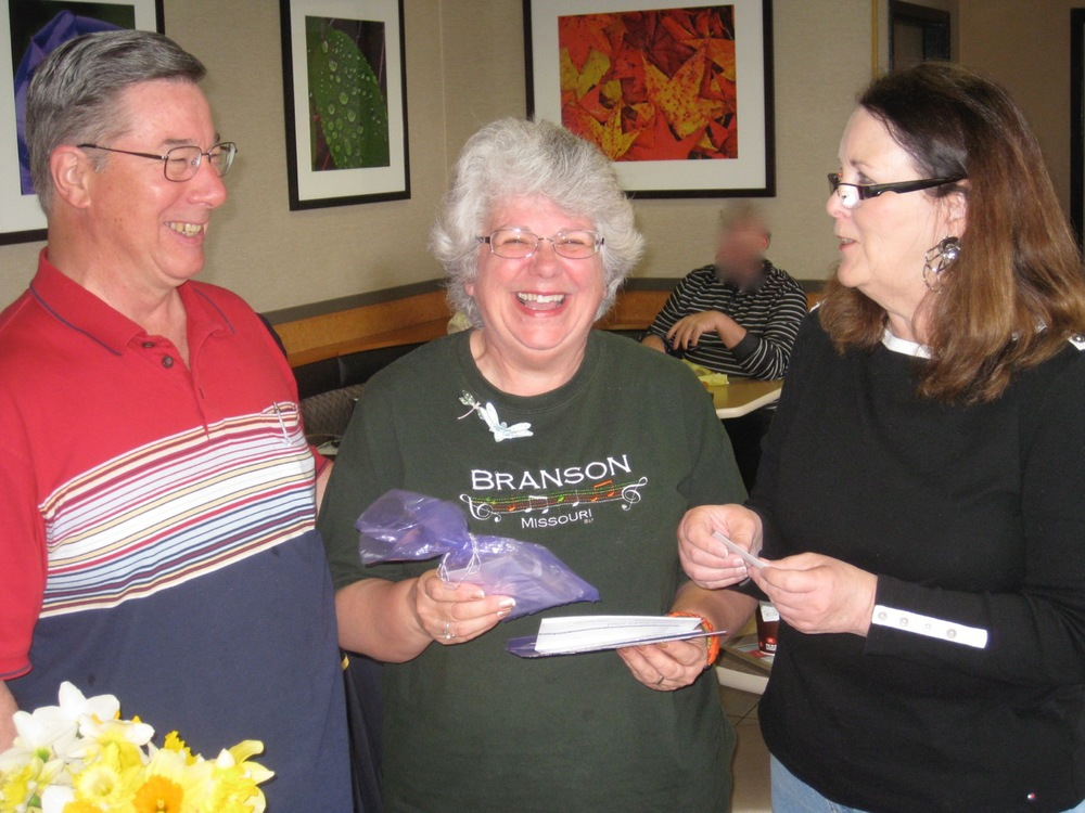 Dennis and Susan Oldacre were very excited to receive the tickets for Frontier Airlines from JA member Sheryl Schiller.