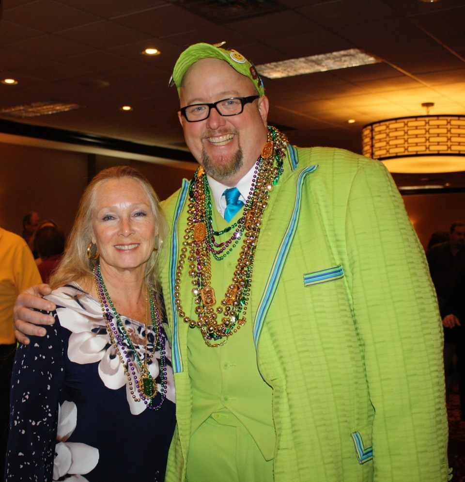 Emcee Shannon Thomason and JA Life Member Suzanne Newkirk ham it up at Junior Auxiliary Mardi Gras Trivia Night