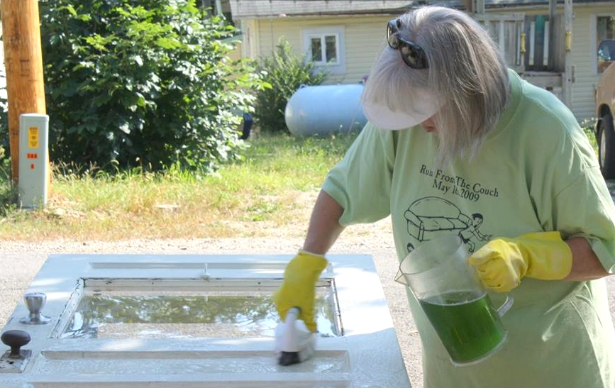 Diane Staggs cleans the front door for painting.
