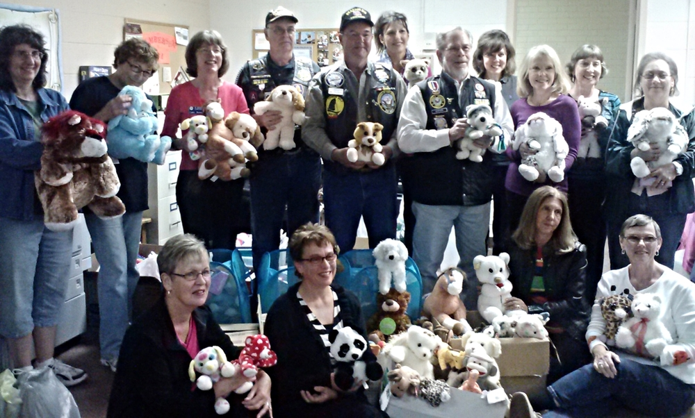 Pictured, back row from left, Donna Harris, Nina Grayson, Cathy Brown, Ron Simmons, Roger Womack, Janet Richardson, Robert Sarver, Jennifer Holmes, Rita Parsons, Carol Miller and Lois Simmons; front row, Donna Handel, Karen Oswald, Brenda Galyean and Ginny Hale. Approximately 300 stuffed animals were collected.