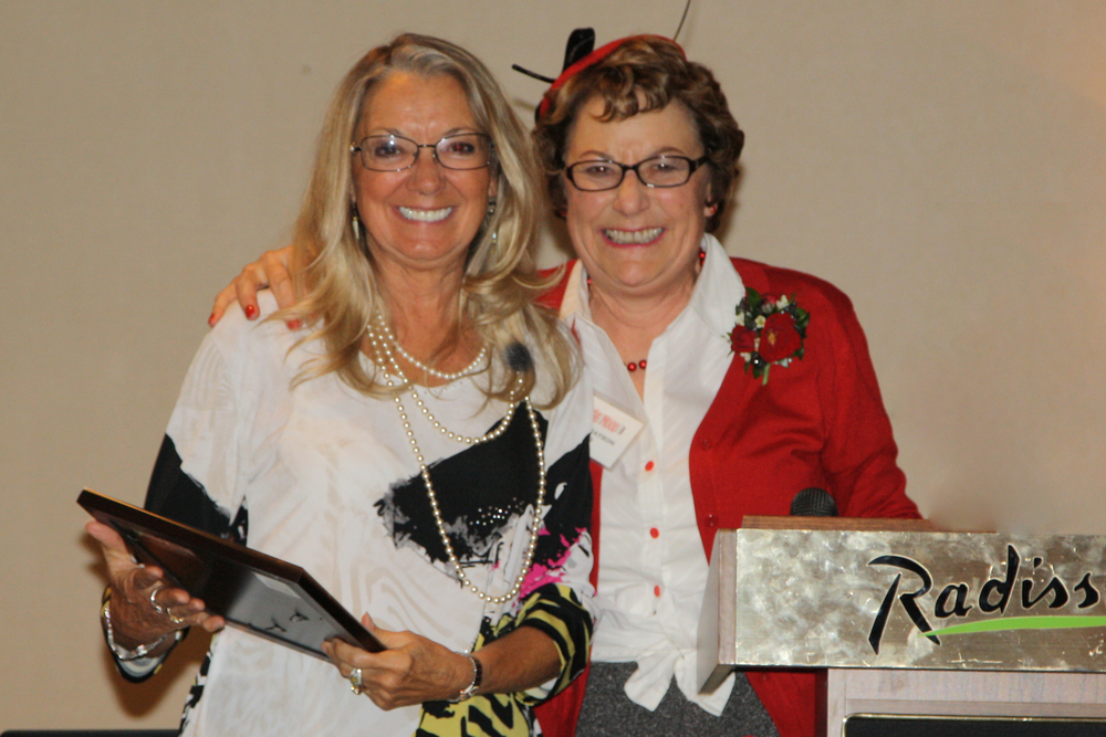 Pat Lambert receives a Sustaining Membership to JATC from Vice President, Nina Grayson.
