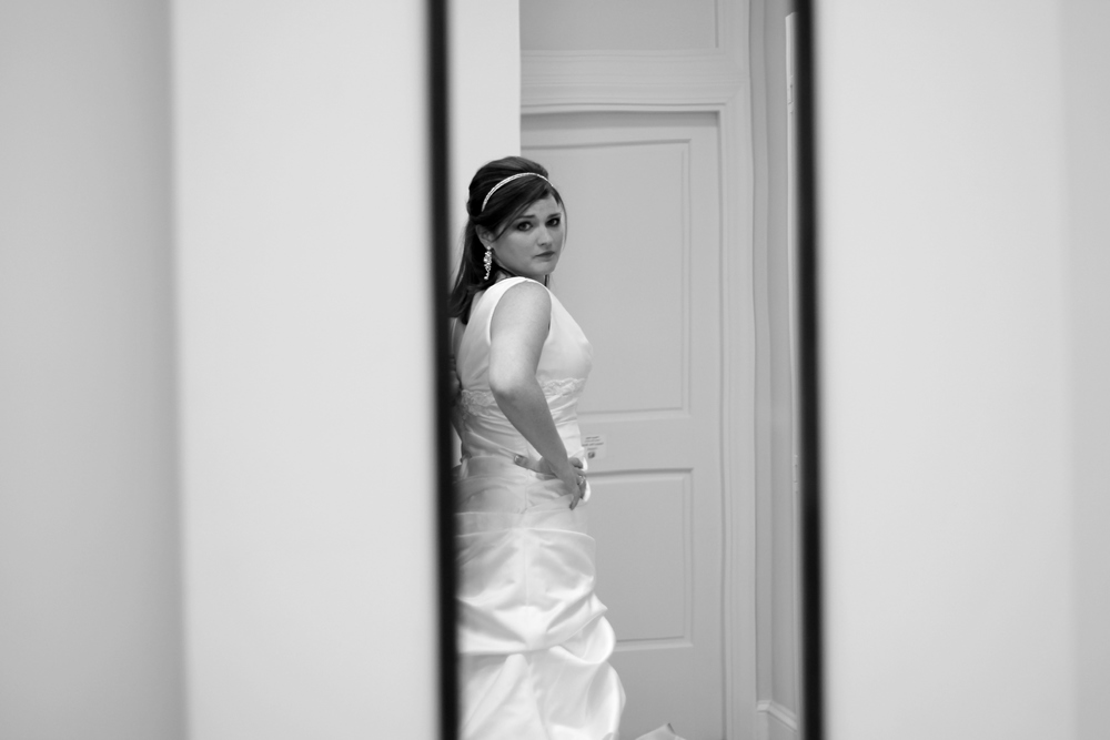 Bride looking in mirror before ceremony