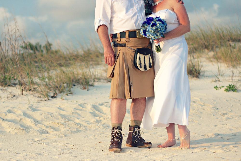 Wedding Portrait Of Bride In Dress And Groom Kilt With Sand Dunes On Biloxi Beach