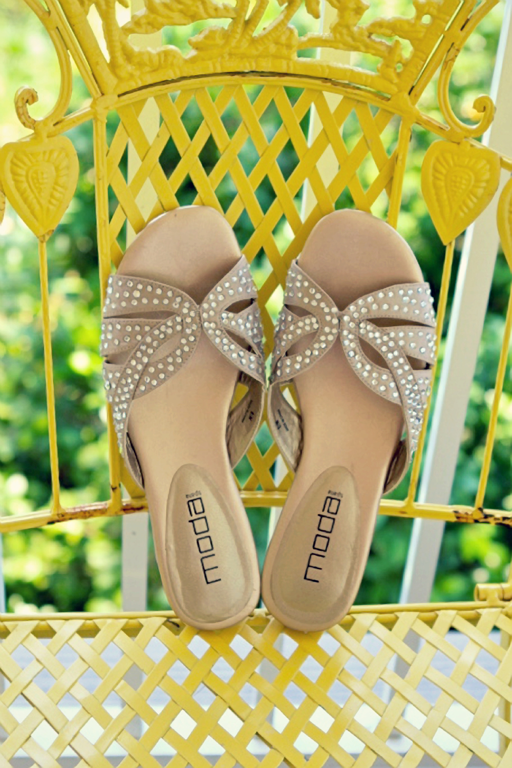 Bride's gold wedding shoes on yellow chair at Emma's Bay House in Fairhope, Alabama