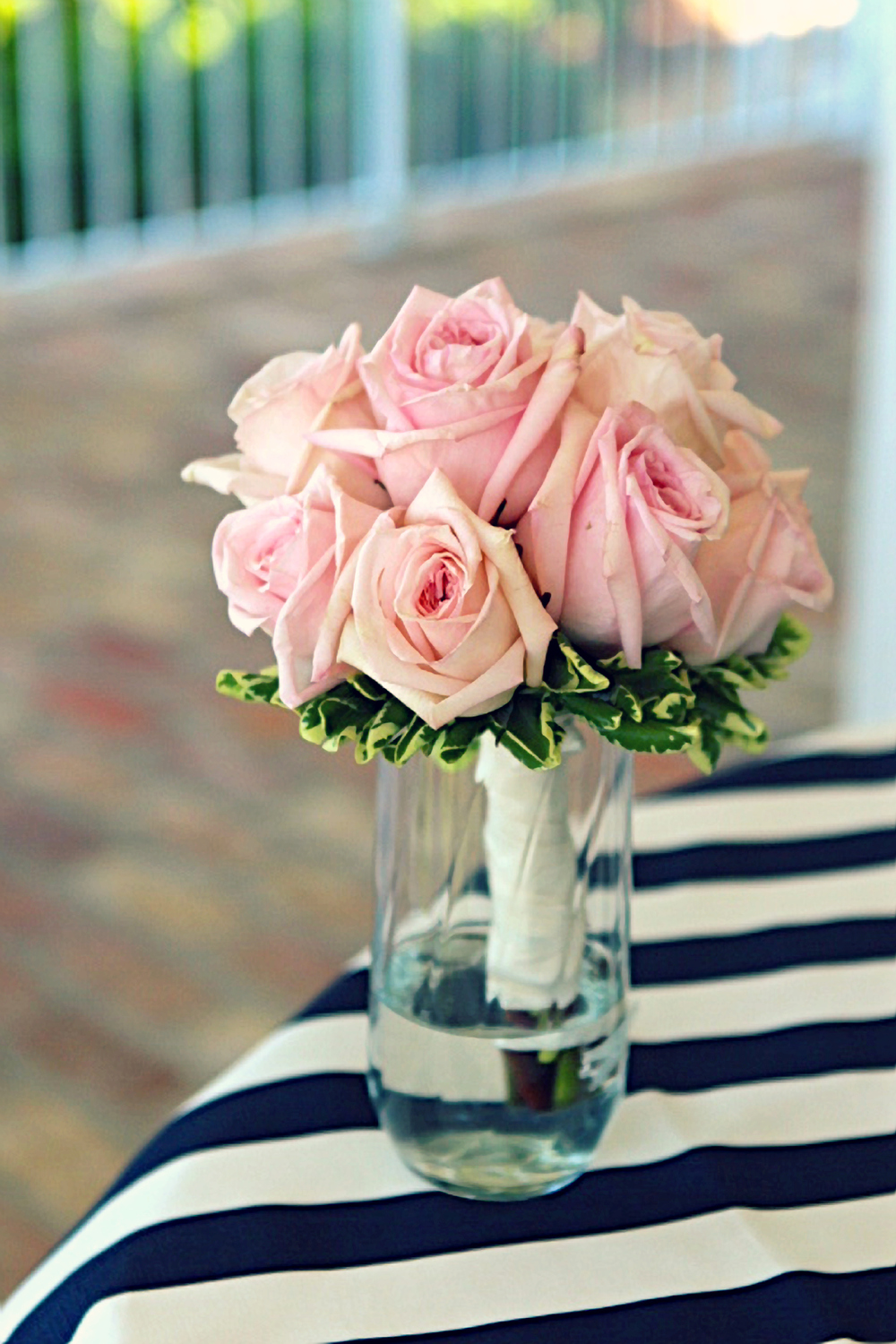 pink bridesmaid bouquet and navy blue striped table decor