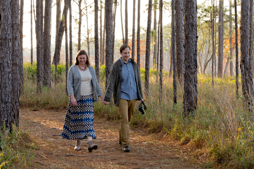engagement photo walking in woods (Uninvented Colors Photography)