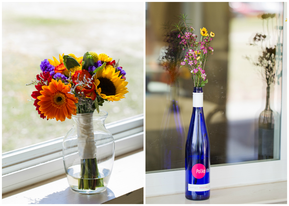 colorful wedding flowers (bouquet and centerpiece with wine bottle)