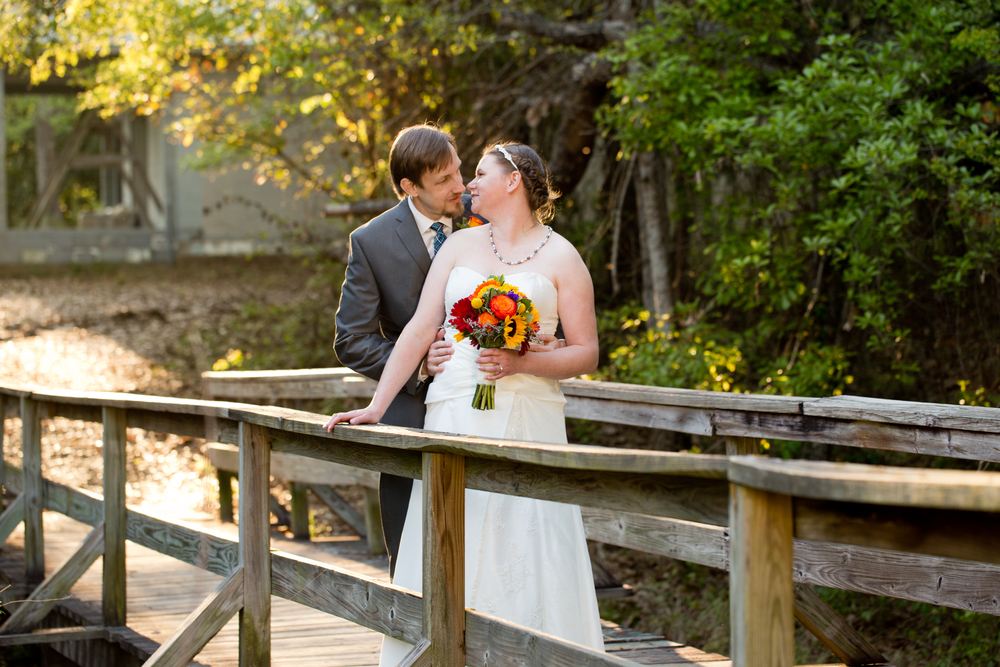 Wedding portrait on rustic bridge at Camp Wilkes in Biloxi